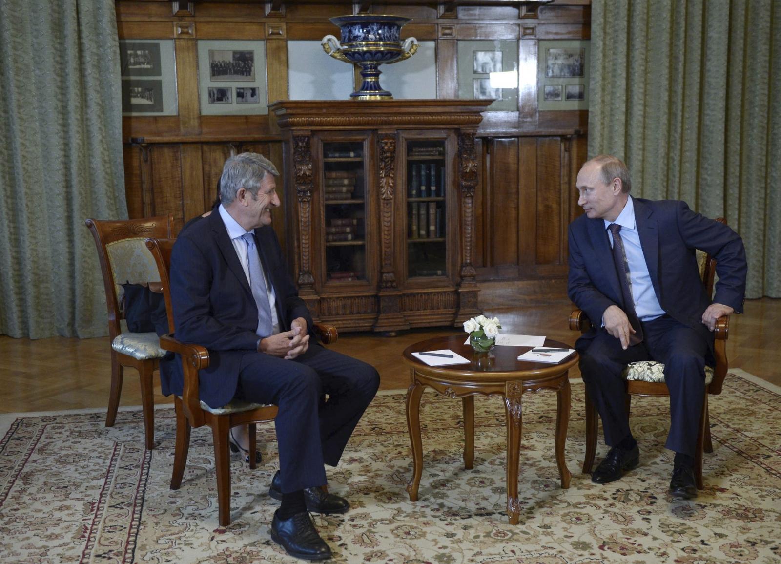 Russian President Vladimir Putin (R) meets with French businessman Philippe de Villiers in Yalta, Crimea,