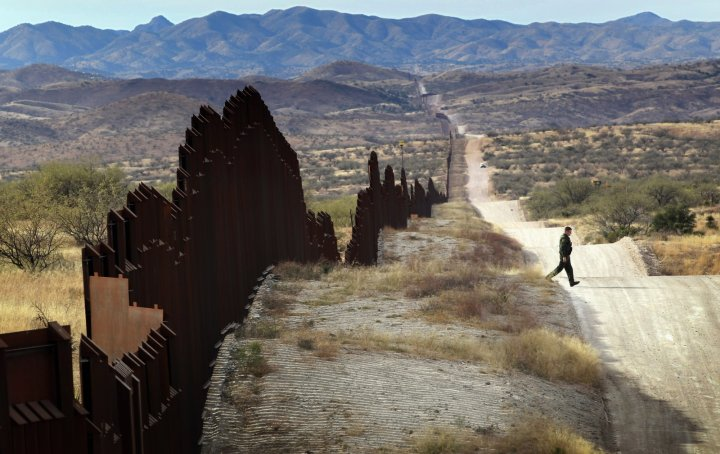 A US police officer patrols the US-Mexican border in Arizona. (Getty)