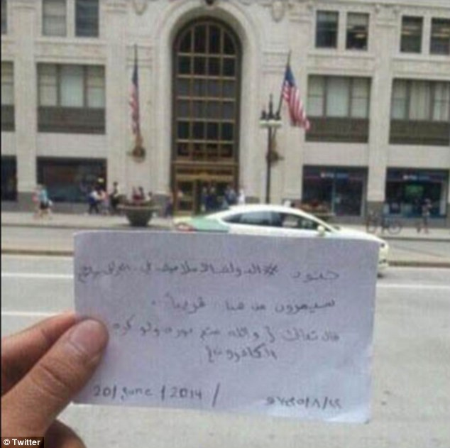 Tweet showing message held up in front of Chicago's Old Republic building. 'Soldiers of the Islamic State of Iraq and Syria will pass from here soon' it reads. (Twitter)