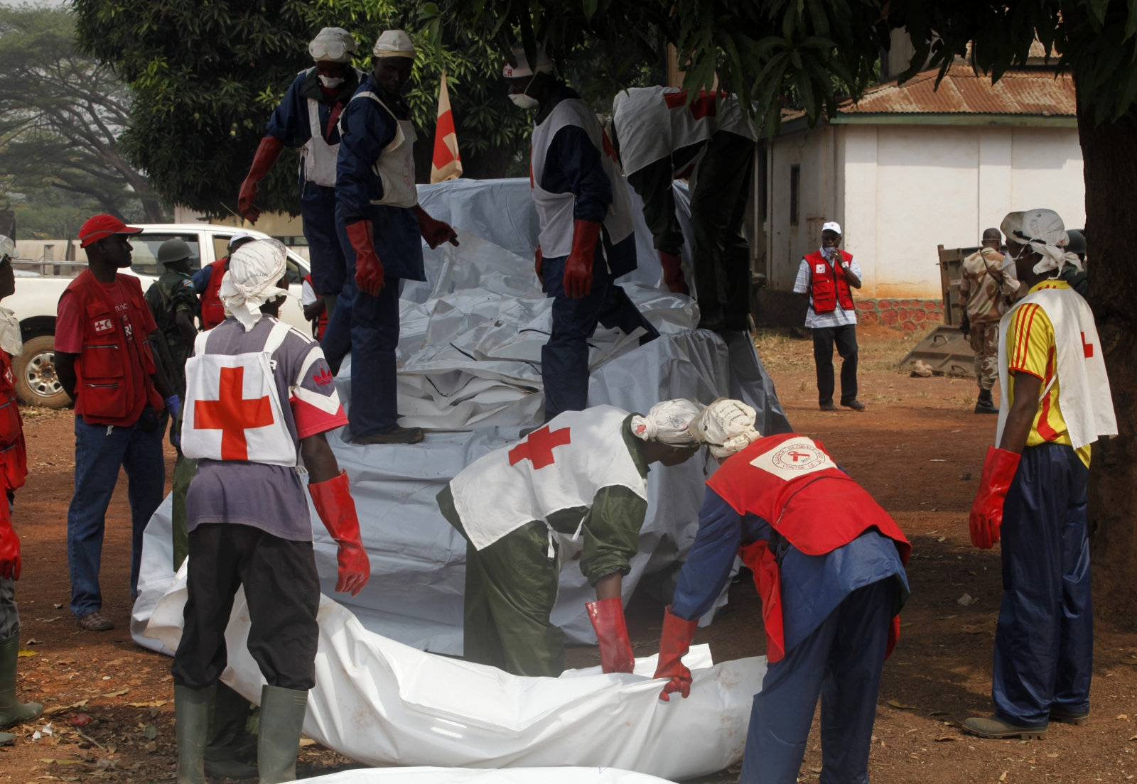 Red Cross workers often face danger, putting their lives at risk to provide humanitarian aid.