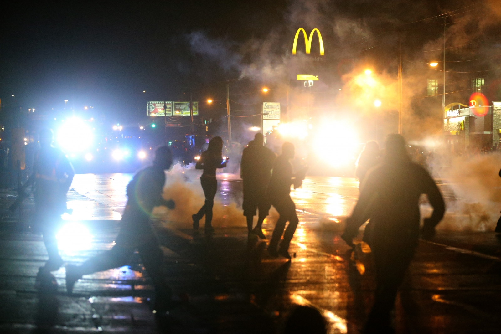 Police fire tear gas at protesters defying a curfew on the streets of Ferguson, Missouri (Getty)