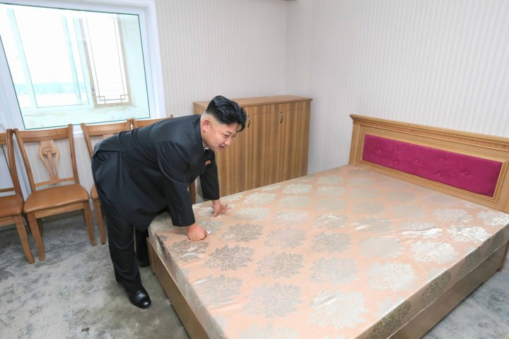 Kim Jong Un inspects a scientist's bed
