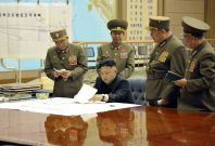 Kim Jong Un at Rocket Force meeting