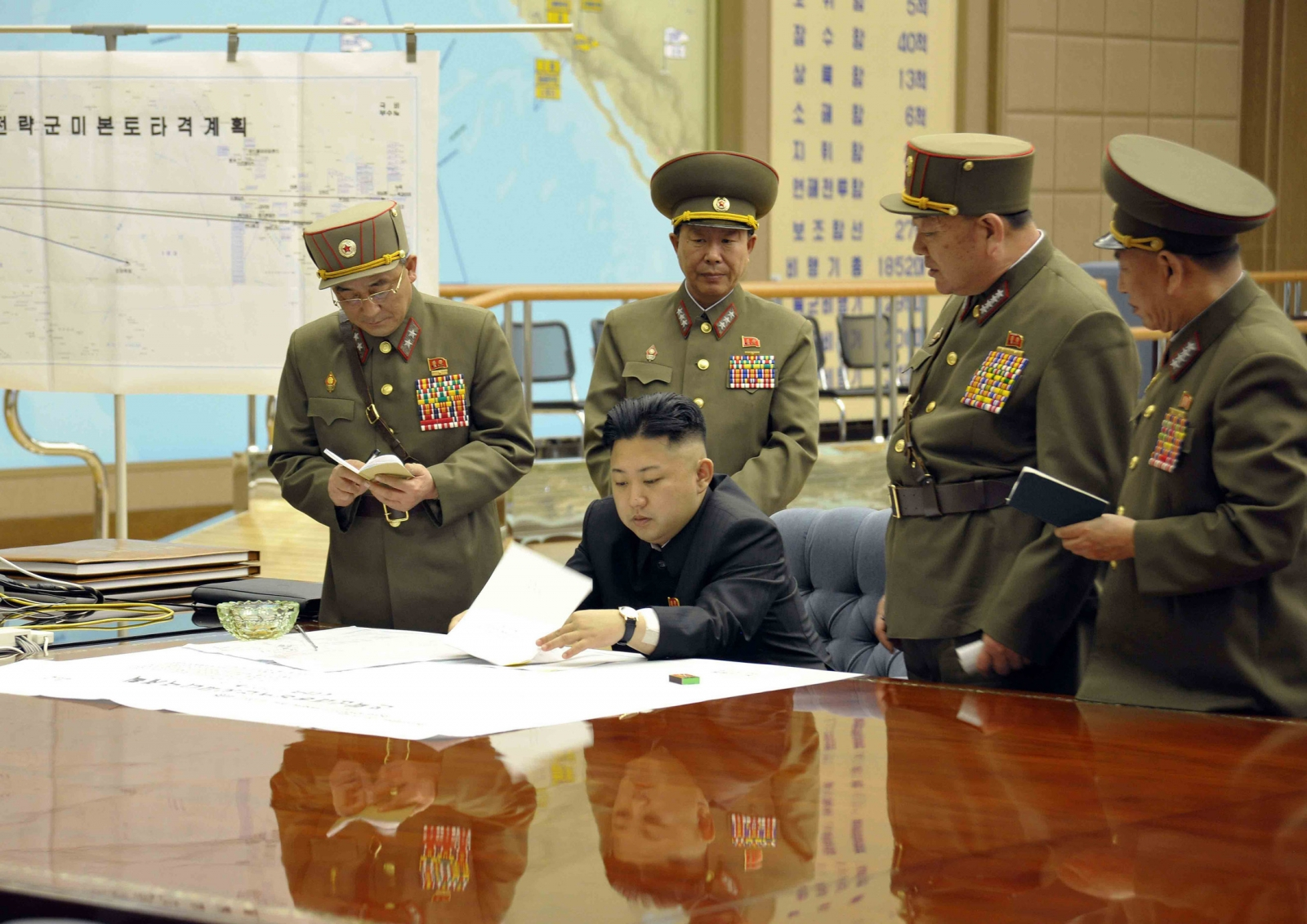 North Korean leader Kim Jong-un meets with his commanders of the Korean People's Army Strategic Rocket Force.