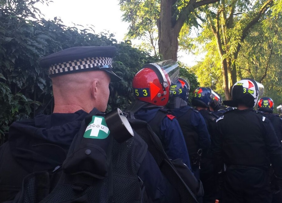 Police prepare to enter a home in raids targeting potential Notting Hill Carnival troublemakers