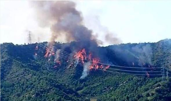A forest fire rages after two Italian Tornado jets crashed into the hills.