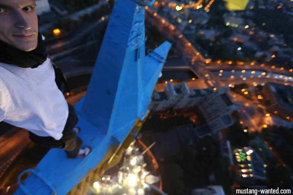 Picture posted on the facebook page of Mustang Wanted, after he painted the Soviet star atop a landmark Moscow building Ukrainian blue. (Facebook)