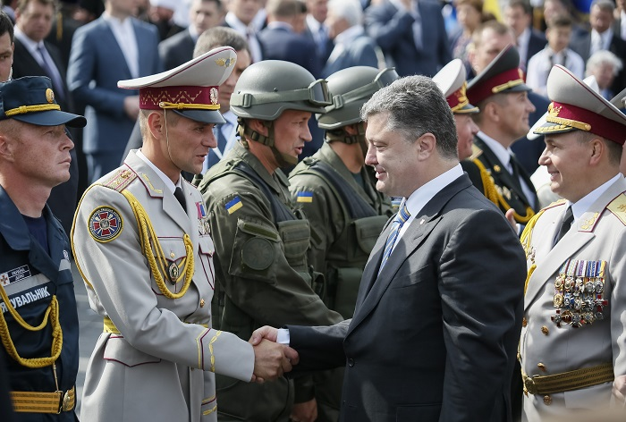 Ukraine's President Petro Poroshenko greets servicemen who participated in Ukraine's Independence Day military parade in the centre of Kiev.