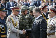 Ukraine\'s President Petro Poroshenko greets servicemen who participated in Ukraine\'s Independence Day military parade in the centre of Kiev.