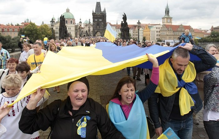 Ukrainians carry the national flag to celebrate the country's Independence Day.