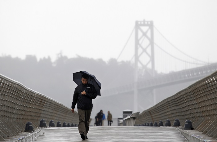 A man walks down Pier 14 in San Francisco, California with the Golden Gate Bridge in the background. Several local residents were woken up by the 6.0-magnitude earthquake that struck Northern California on 24 August.