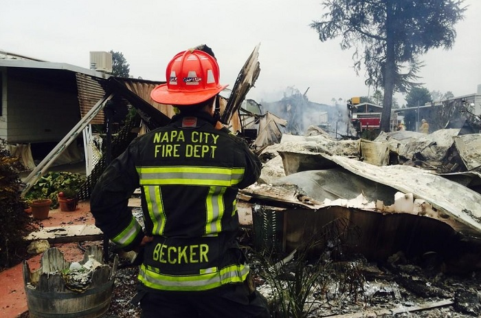 A Napa City firefighter assesses fire damage to homes in the aftermath of the devastating 6.0-magnitude earthquake in Northern California.