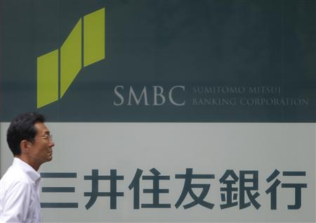 A man walks past a branch of Sumitomo Mitsui Banking Corporation in Tokyo