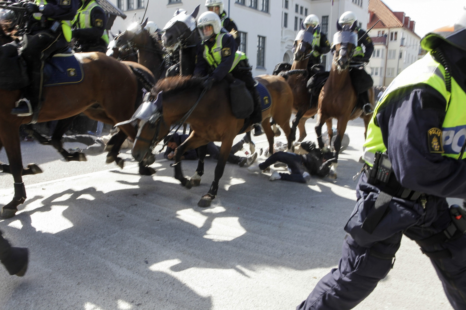 Protesters are seen below mounted police who are controlling a demonstration against an election meeting organised by right-wing political group The Party of the Swedes (Svenskarnas Parti) at a square in central Malmo