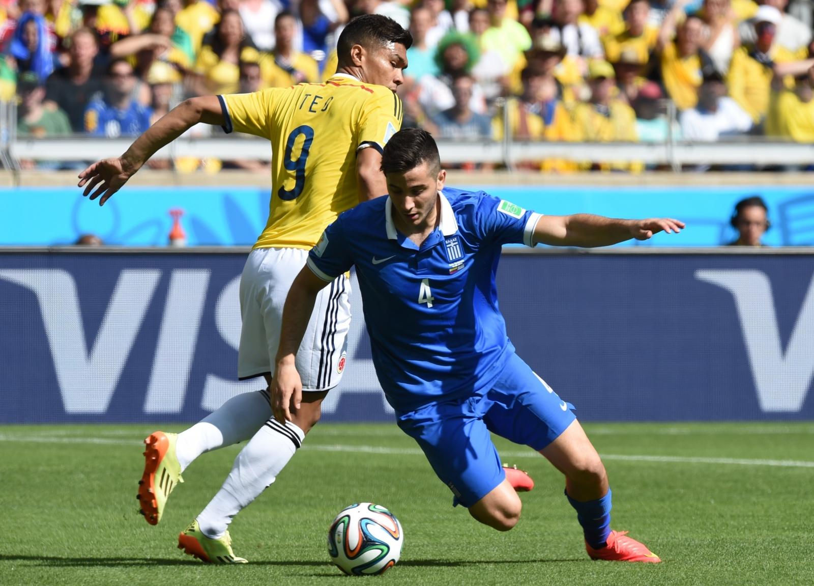 Teofilo Gutierrez in action against Greece's defender Konstantinos Manolas