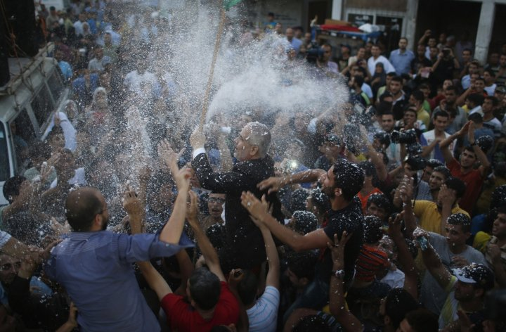 Hamas spokesman Sami Abu Zuhri is doused with foam during celebrations at peace for Gaza in an Israel / Palestine ceasefire
