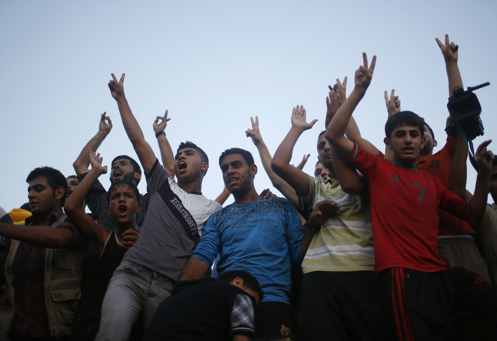 Young men celebrate peace for Gaza in an Israel / Palestine ceasefire