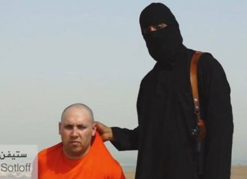 An IS thug grips Steven Sotloff by the collar in chilling video which featured threats to murder US reporter