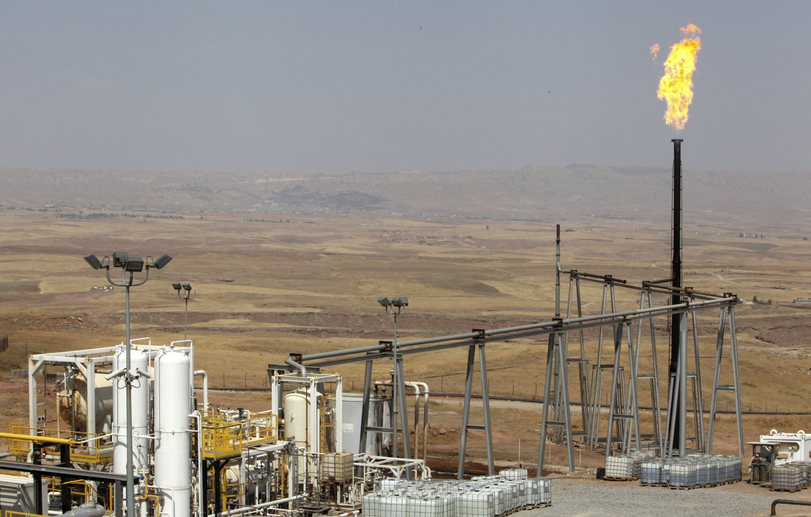A flame rises from a chimney at Taq Taq oil field in Arbil, in Iraq's Kurdistan region