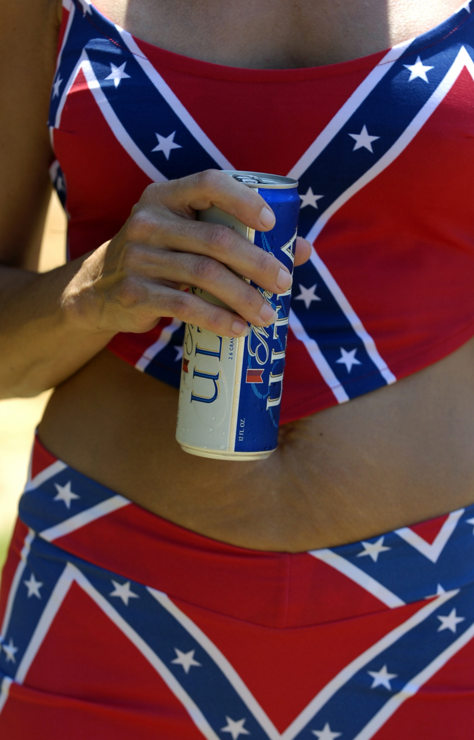 A woman wearing a Confederate flag bikini holds a beer during the annual Redneck Ganmes in Georgia. (Gett/ Stephen Morton))