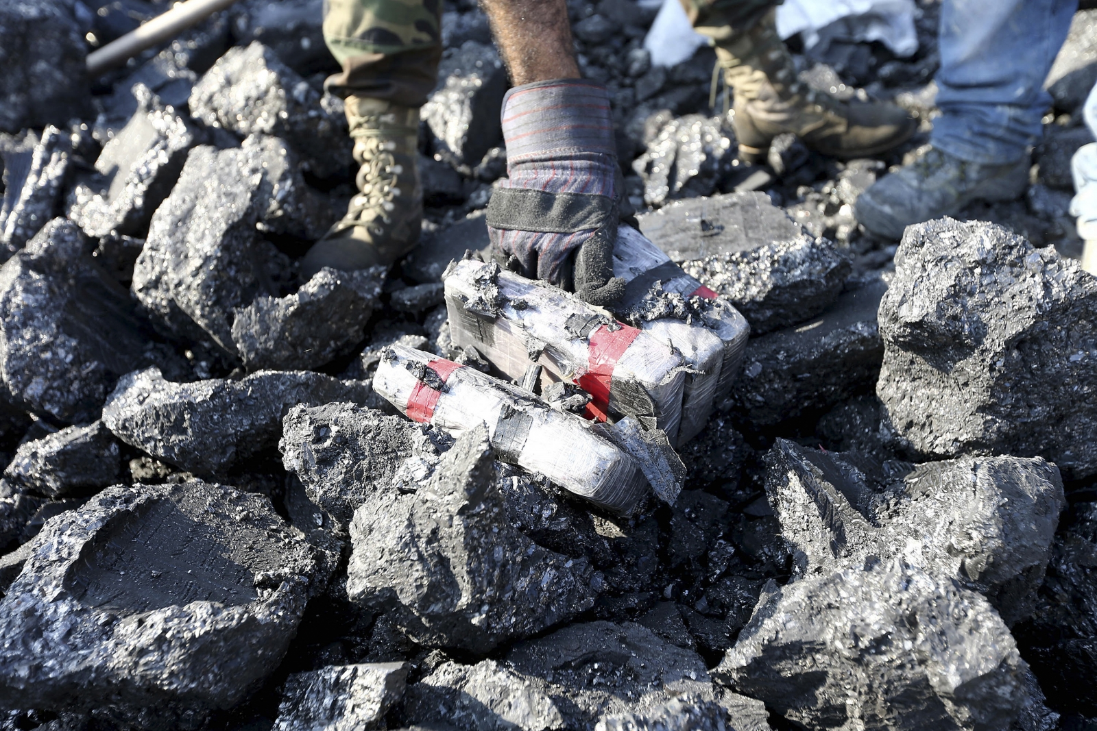 Cocaine seized by police in Huanchaco, Peru. Packets were concealed in hollowed out coal bricks. (Reuters)