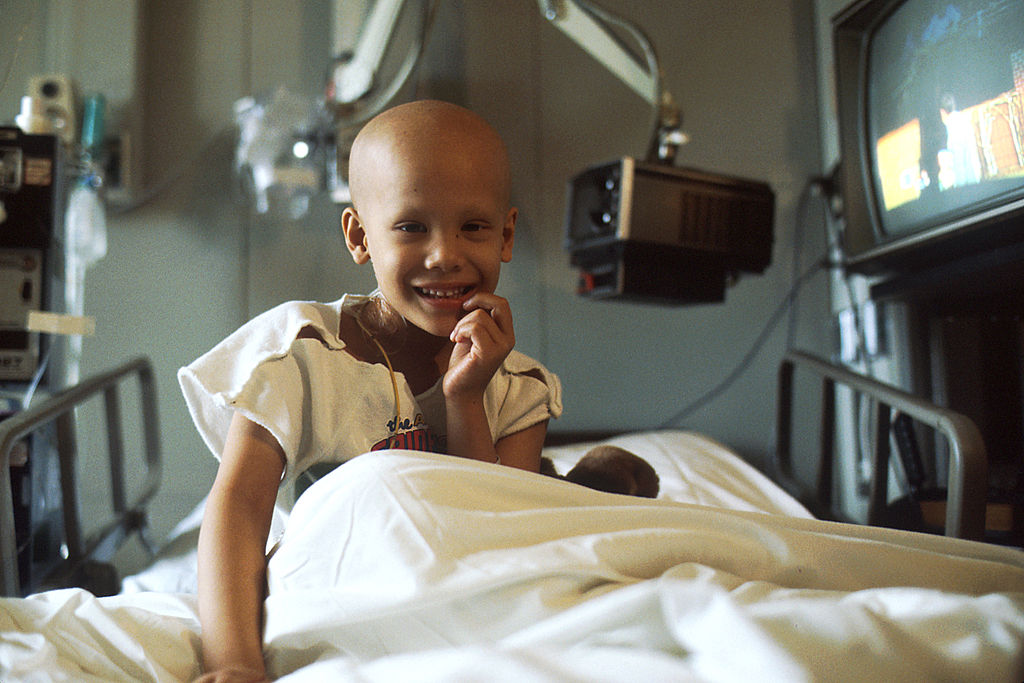 A young child receives chemotherapy