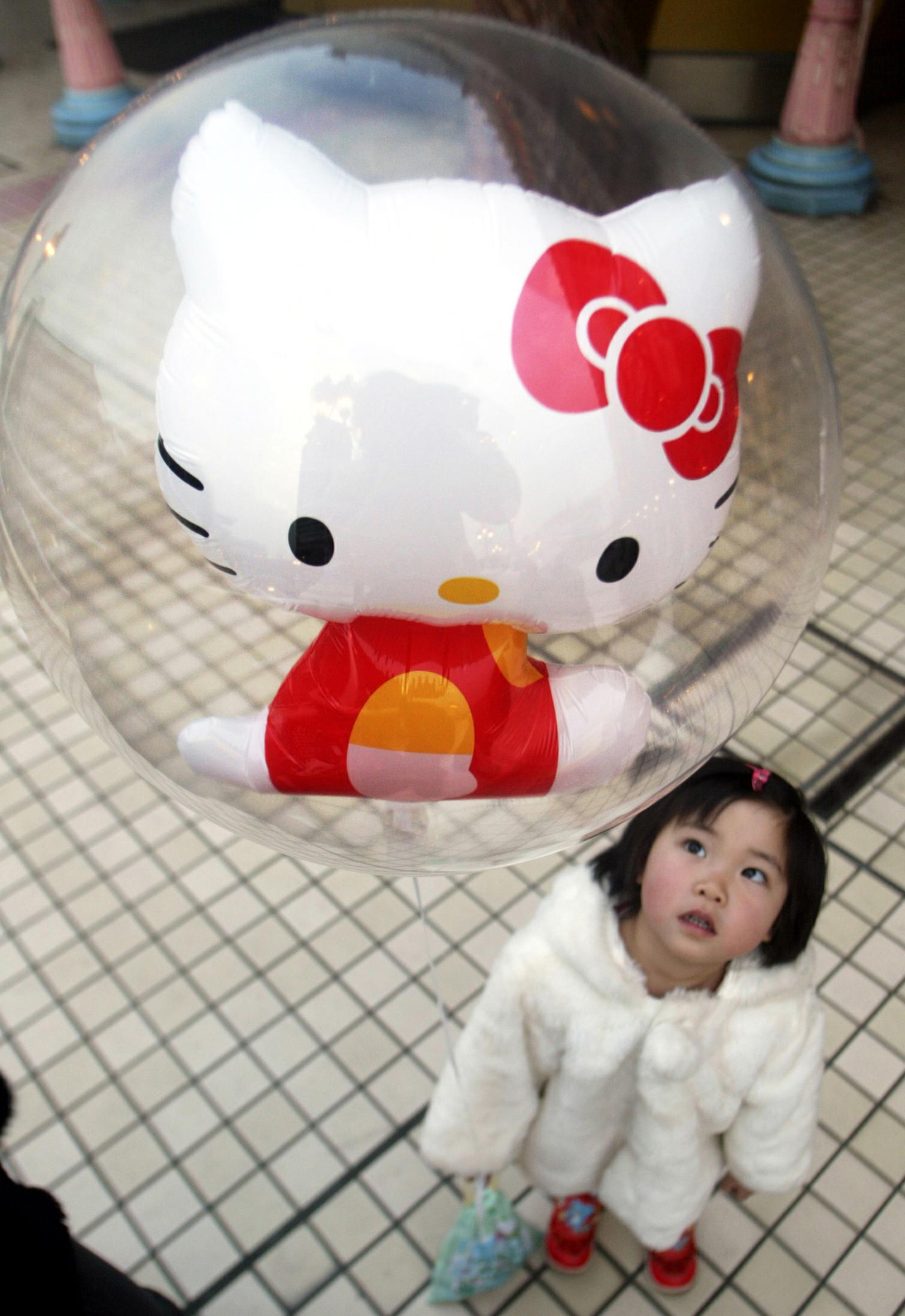 Hello Kitty balloon and child