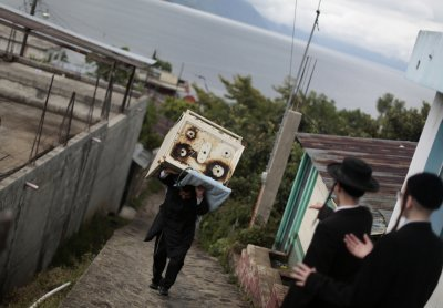 Lev Tahor Man Carrying a stove