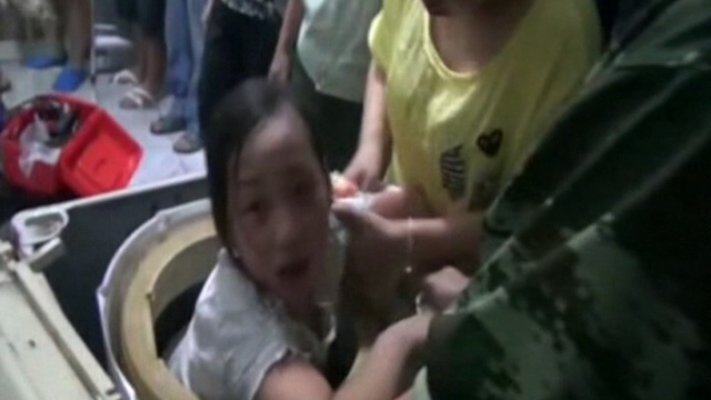 Firefighters Rescue Girl Trapped in Washing Machine