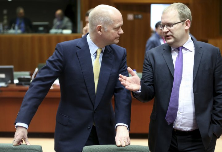 British Foreign Secretary William Hague (L) listens to Estonia's Foreign Minister Urmas Paet