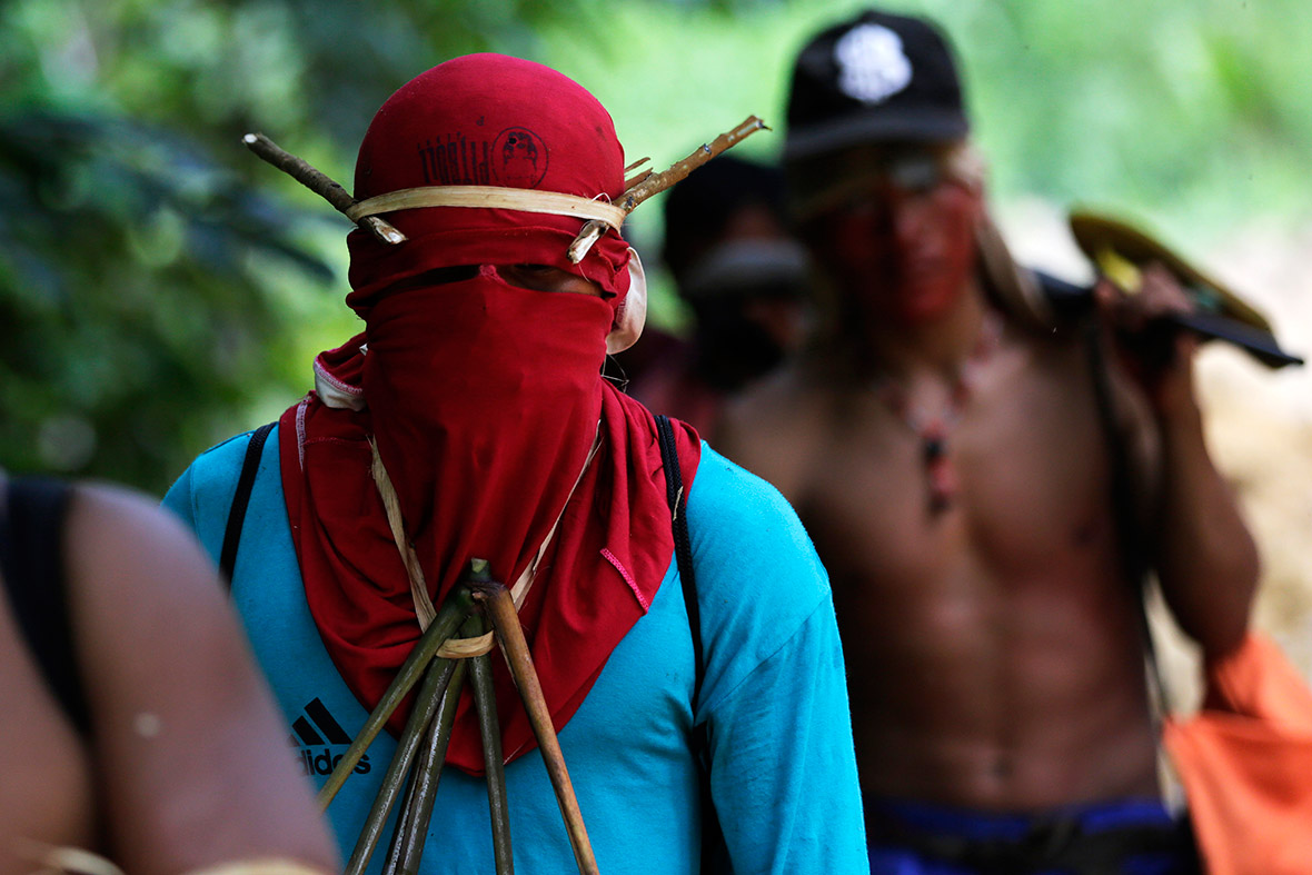 Ka'apor warriors hike through the Amazon to search for and expel loggers