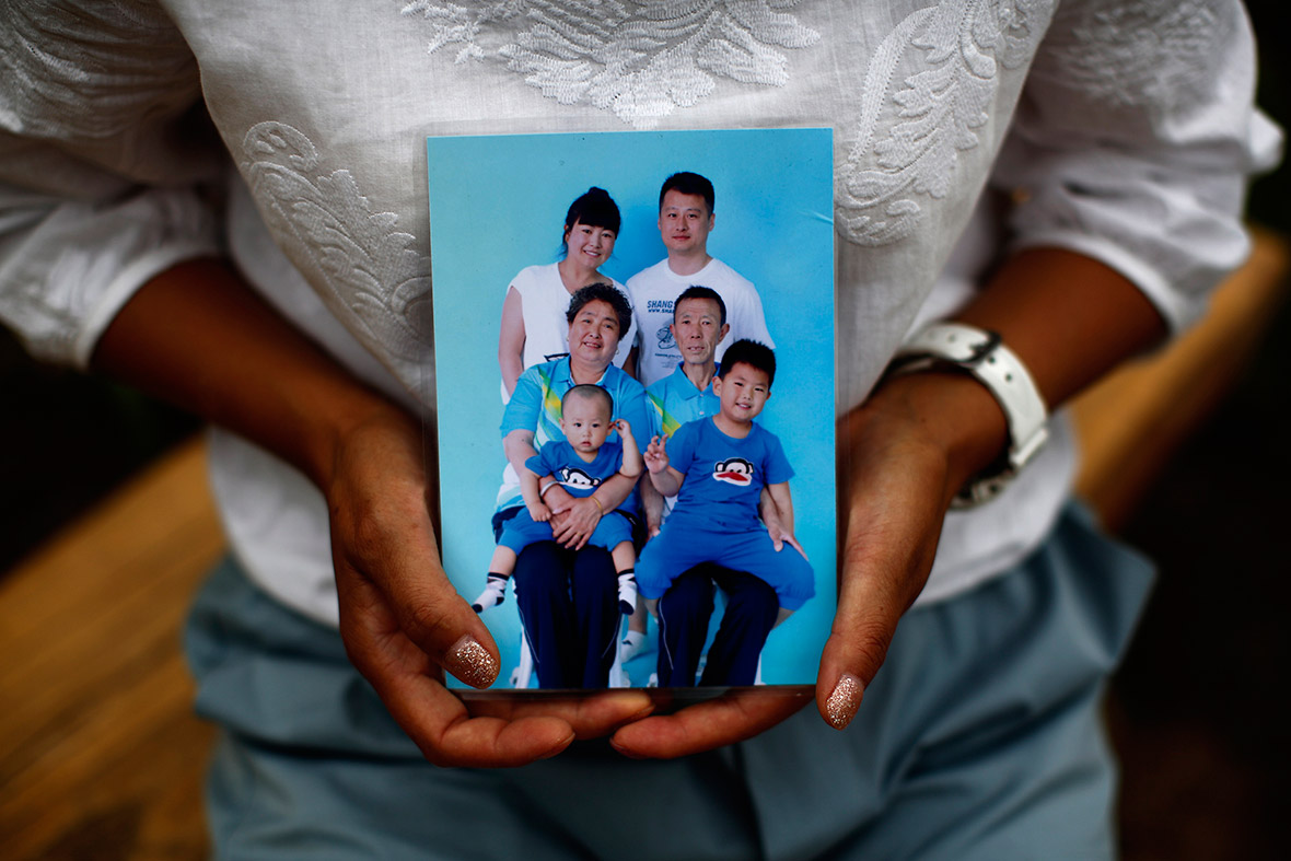 Cheng Liping shows a family photo featuring her missing husband.  Cheng said her life has been totally changed since the incident. Their two sons, who dont know about the missing plane, keep asking her when their dad is coming bac
