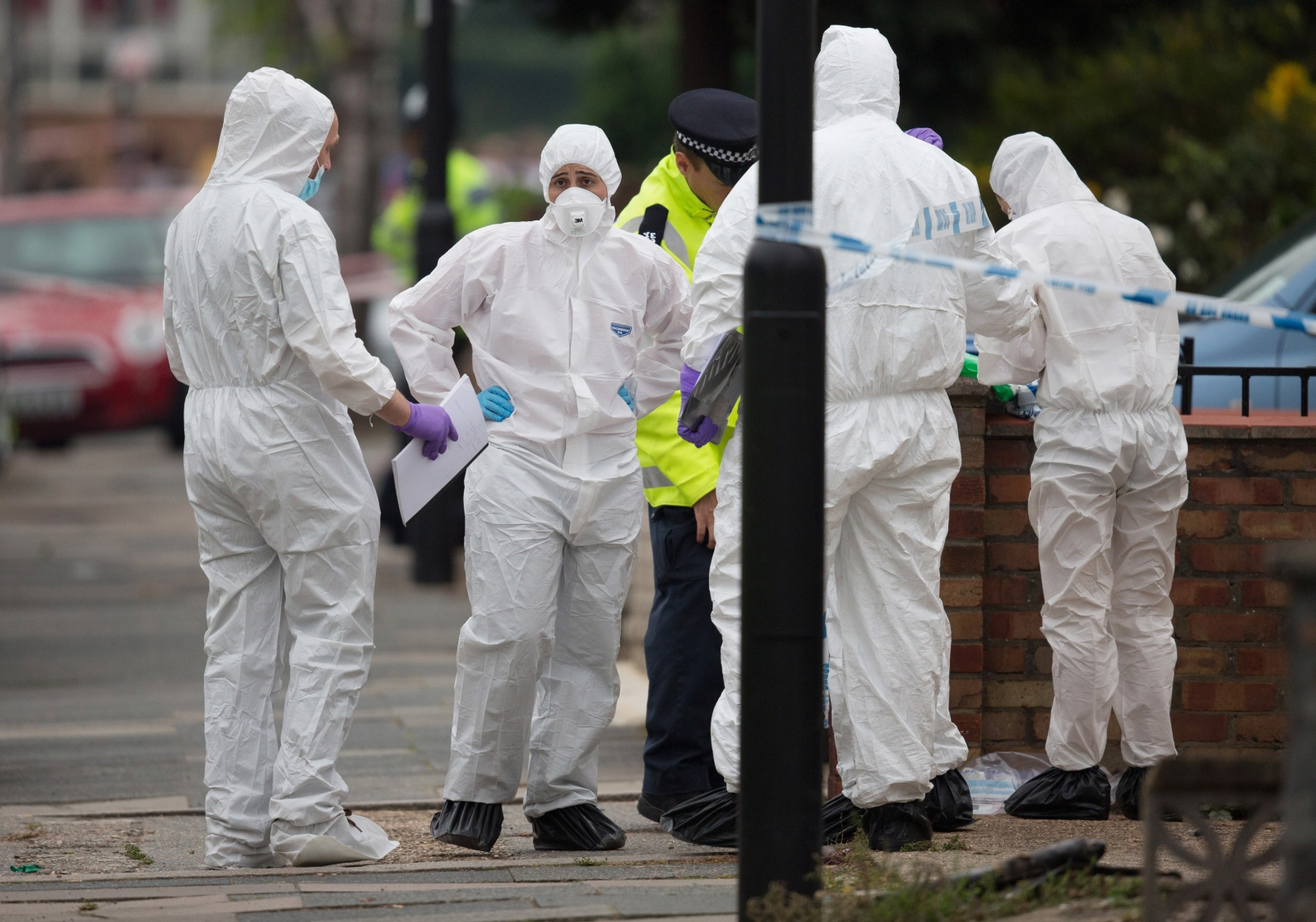 Forensic investigators at scene where machete killer attacked three people and beheaded Palmira Silva