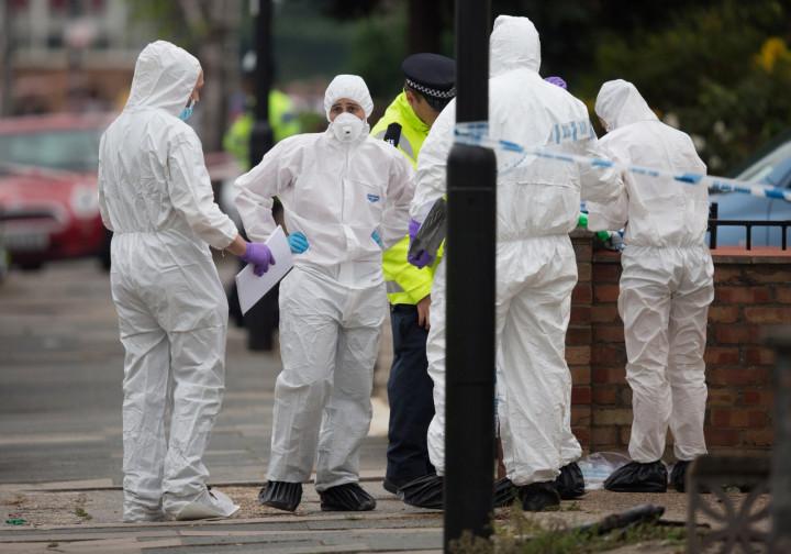 Forensic investigators at scene where machete killer attacked three people and beheaded Palmira Silva