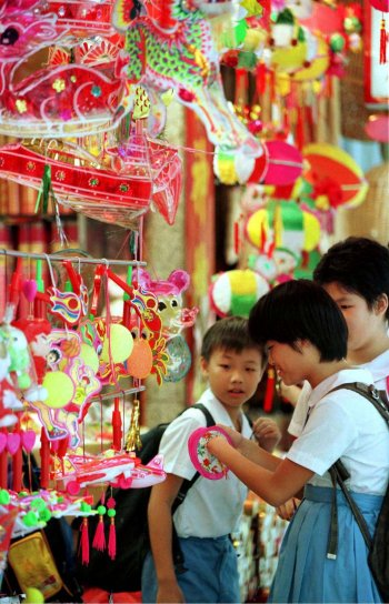 Children looking at Mid-Autumn Festival lanterns