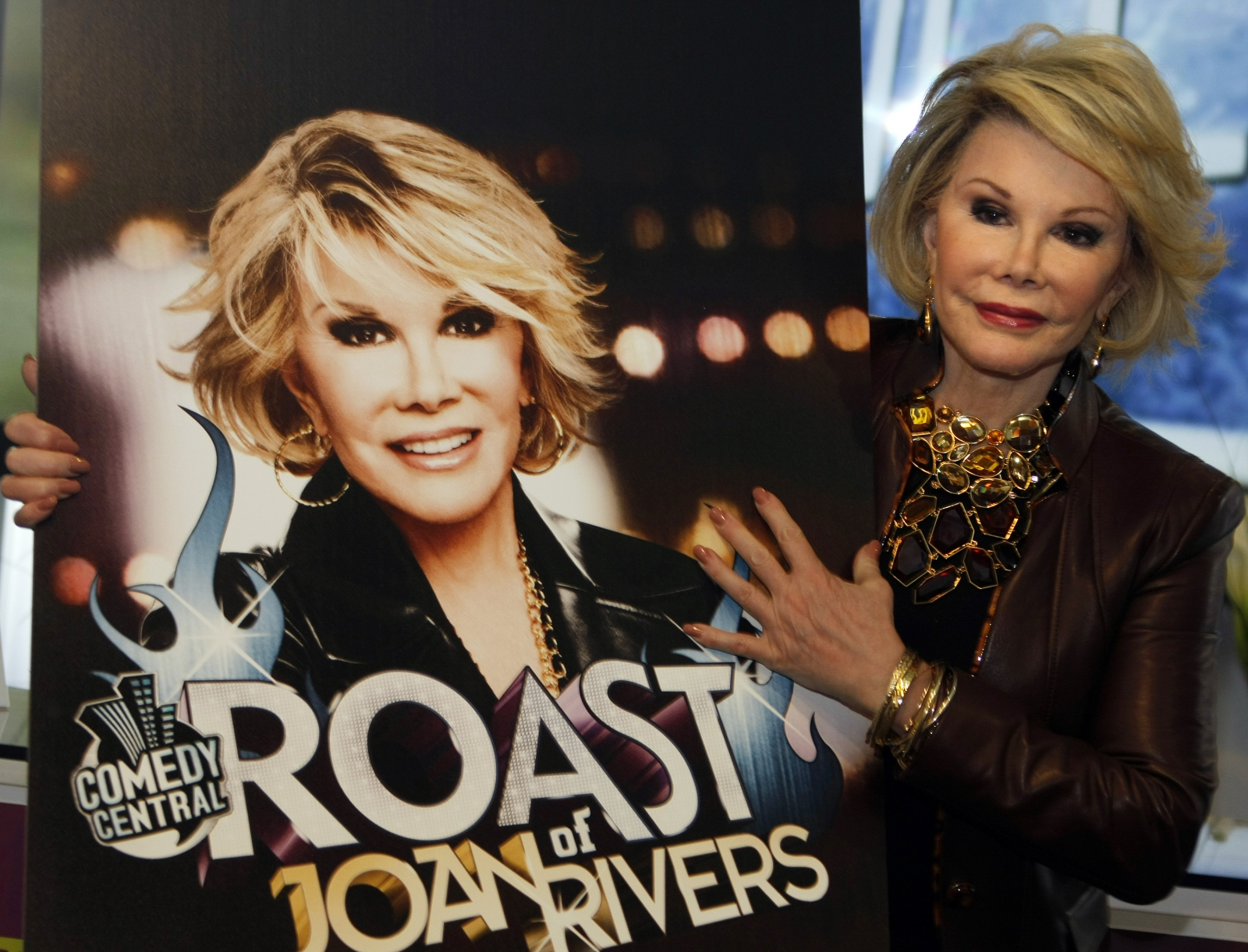 """Joan Rivers posed for photographers as she presented """"Comedy Roast with Joan Rivers"""""""