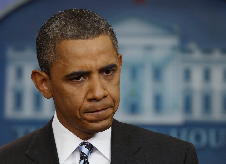 US President Obama pauses during a news conference in the Brady Press Briefing Room at the White House in Washington