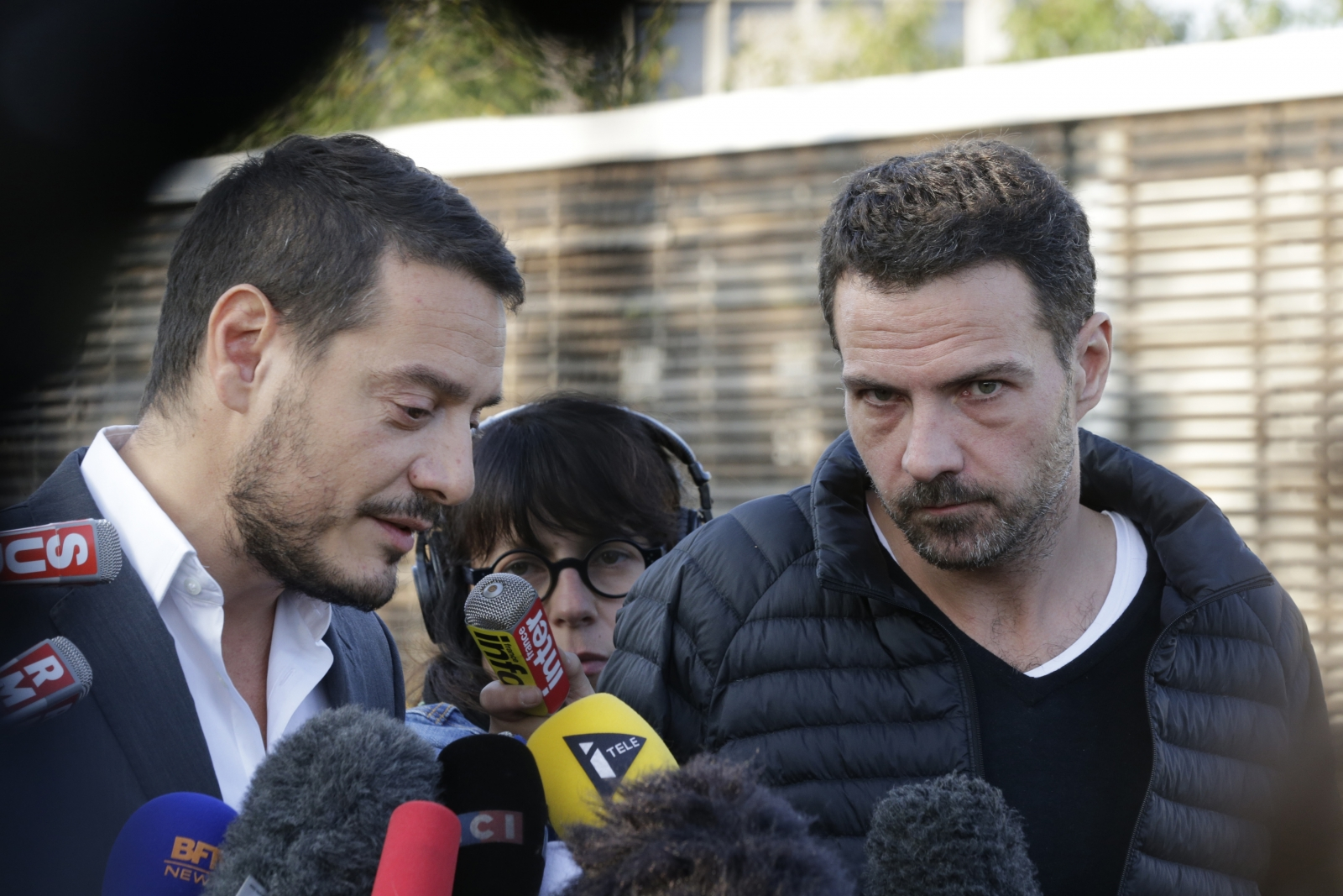Former French trader Jerome Kerviel (R) and his lawyer David Koubbi speak to the media outside the Fleury-Merogis prison near Paris September 8, 2014.