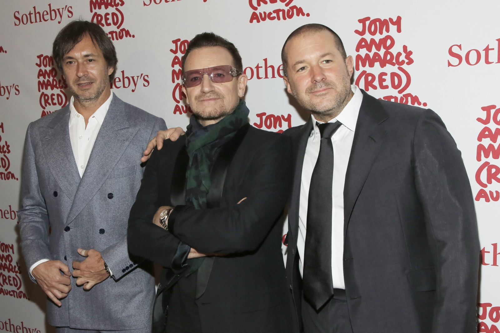Designer Marc Newson (L), Singer Bono (C) and Apple's Senior Vice President of Design Jony Ive attend Jony And Marc's (RED) Auction at Sotheby's in New York