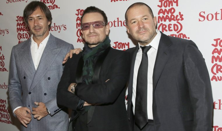 Designer Marc Newson (L), Singer Bono (C) and Apple\'s Senior Vice President of Design Jony Ive attend Jony And Marc\'s (RED) Auction at Sotheby\'s in New York