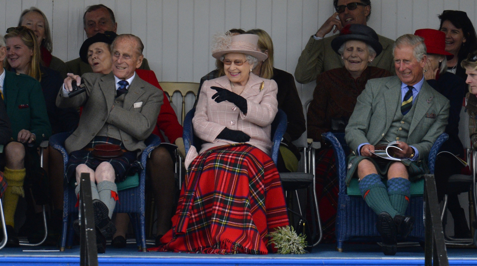 Prince Philip (L), Queen Elizabeth (C) and Prince Charles (R) at the Braemar Gathering in Scotland