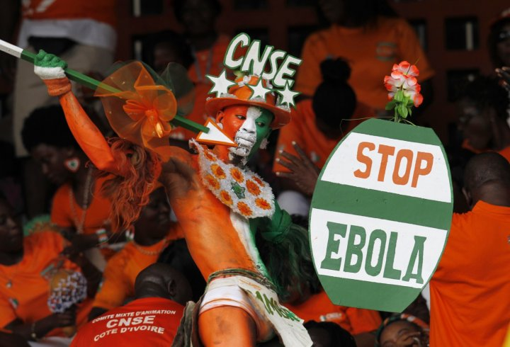 A fan of Ivory coast holds a sign with a message against Ebola during the 2015 African Nations Cup between Ivory Coast and Sierra Leone