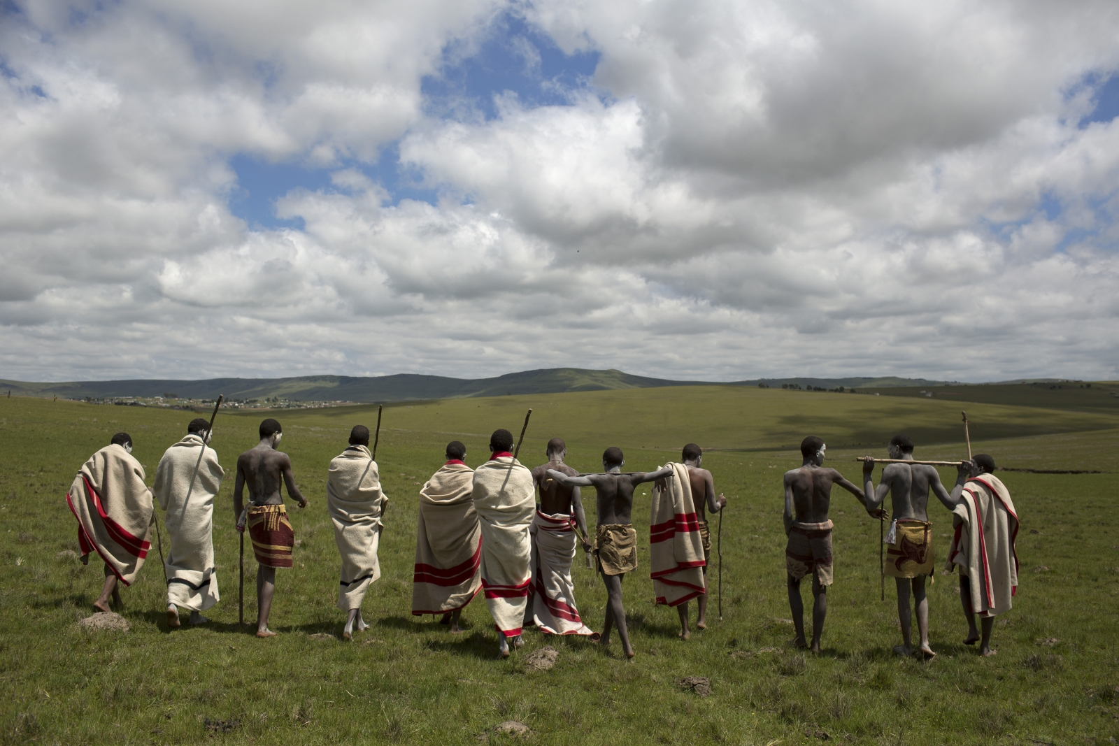 Circumcision initiates pose as they walk on a field in Qunu, in the Eastern Cape