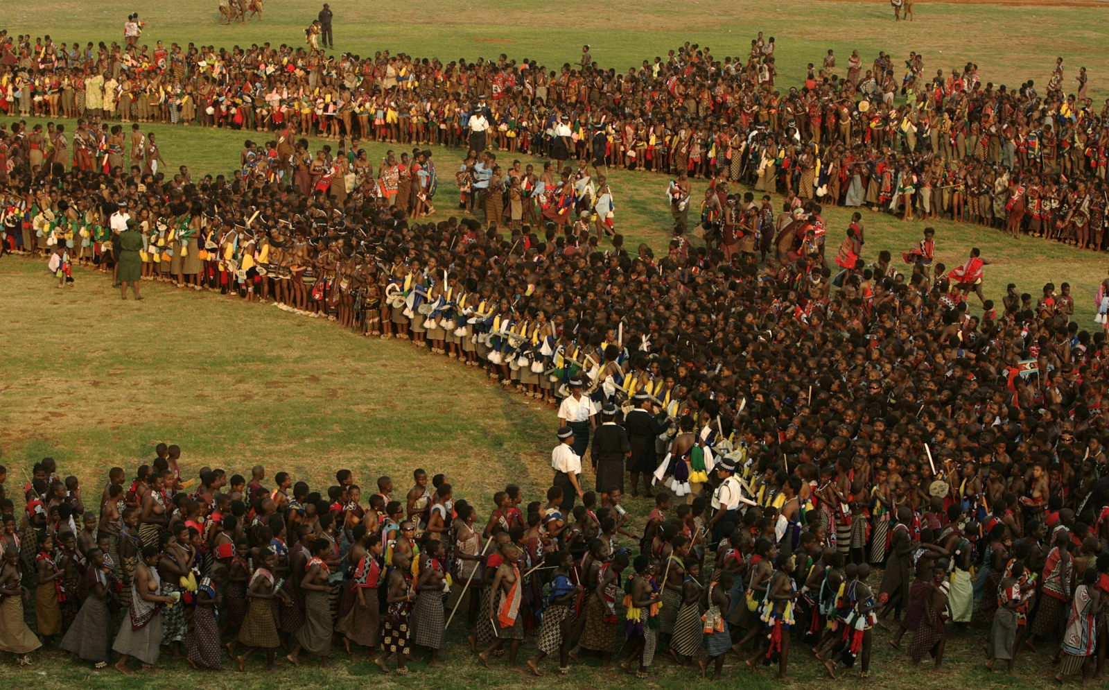Bare-breasted virgins competing for King Mswati III's eye take part in a traditional Reed Dance at Ludzidzini, the royal palace in Swaziland August 31, 2008.