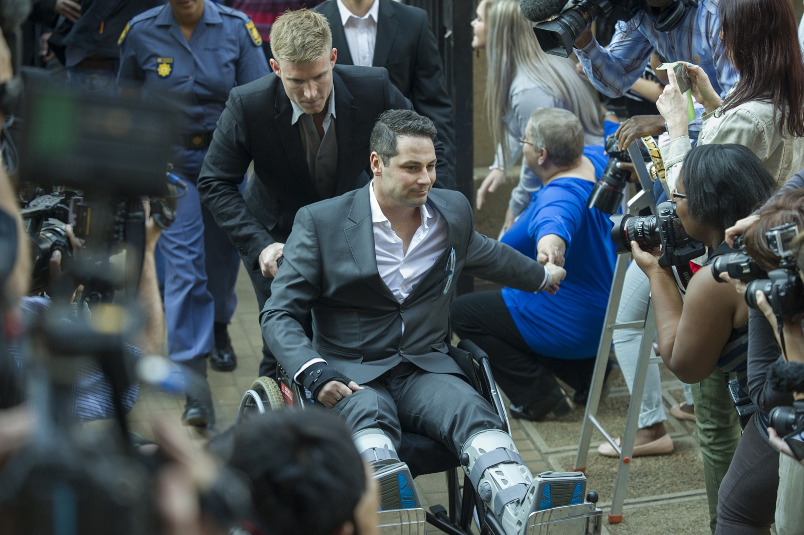 Carl Pistorius, the brother of Oscar, arrives at court in a wheelchair