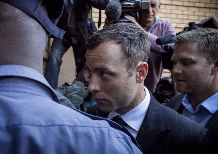 Oscar Pistorius arrives at court for judgement day in his murder trial