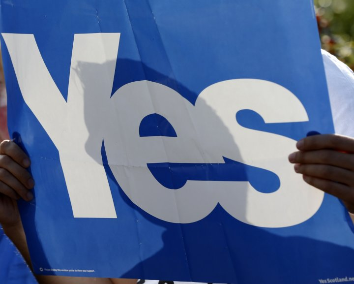 A 'YES' supporter holds a banner in Cumbernauld in Glasgow, Scotland September 10, 2014.