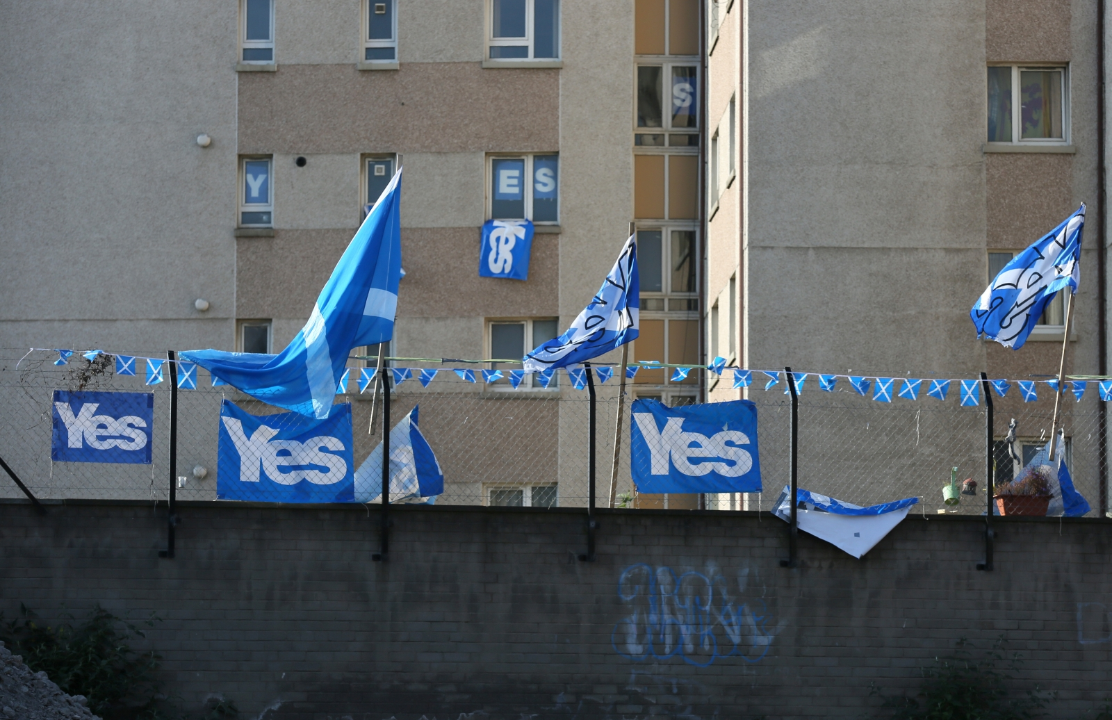 'YES' campaign flags fly from a fence near a tower block in Edinburgh September 10, 2014.