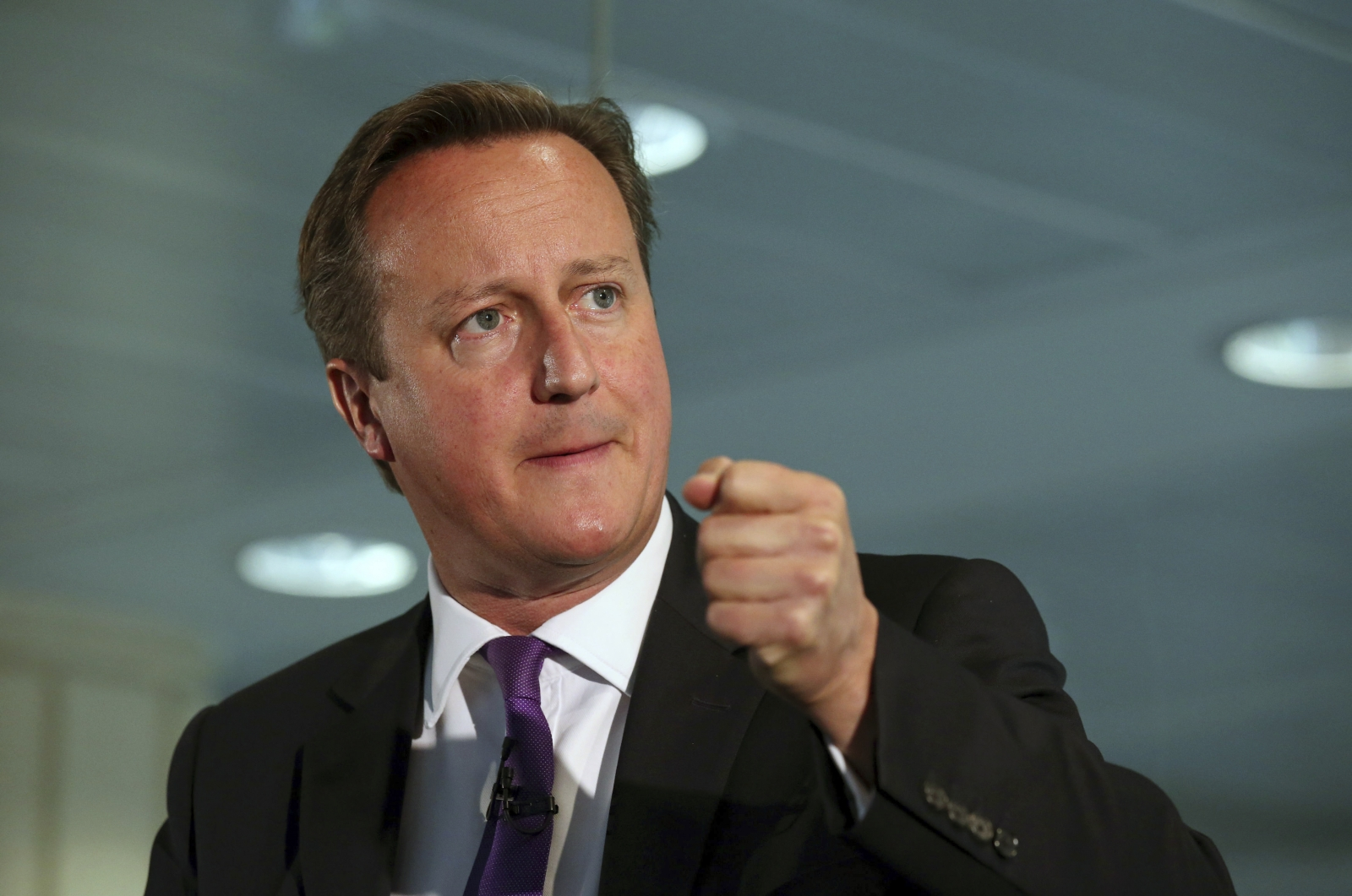 Britain's Prime Minister David Cameron gestures as he speaks during a visit to the Scottish Widows building in Edinburgh, Scotland September 10, 2014.
