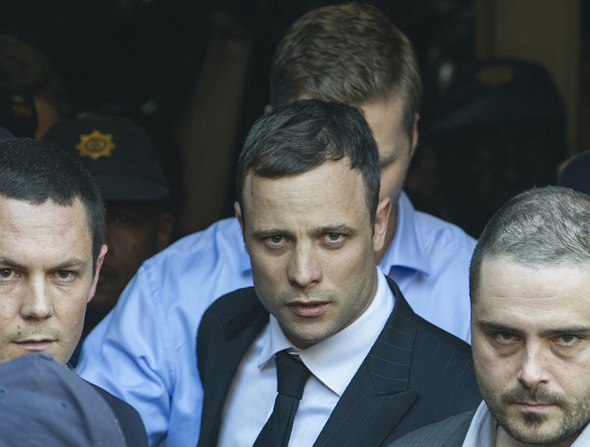 Oscar Pistorius leaves court after day one of the verdict in his trial for killing Reeva Steenkamp